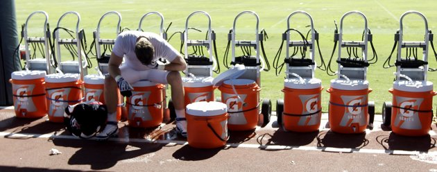 Houston Texans defensive end Jesse Nading sits on a cooler after a workout at NFL football training camp in the hot weather, Thursday, Aug. 4, 2011, in Houston. (AP Photo/David J. Phillip)