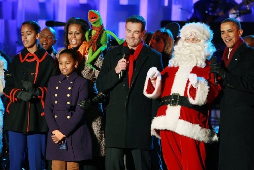 WASHINGTON, DC - DECEMBER 01: President Barack Obama (R), Santa Clause (2nd-R), Carson Daly (C), Kermit the Frog, first lady Michelle Obama, and daughters, Sasha and Malia, sing a song during the National Christmas Tree light ceremony on December 1, 2011 at the Ellipse, south of the White House, in Washington, DC. The first family participated in the 89th annual National Christmas Tree Lighting Ceremony. (Photo by Mark Wilson/Getty Images)