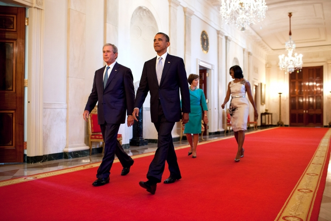 President Barack Obama and First Lady Michelle Obama walk with former President George W. Bush and former First Lady Laura Bush in the Cross Hall towards the East Room of the White House, May 31, 2012. The President and First Lady hosted a ceremony presenting the Bush's official portraits, which will be displayed in the White House. (Official White House Photo by Chuck Kennedy)