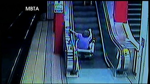 Motorized Wheelchair Vs. Escalator Turns Out Exactly As You'd Expect – Hilarious