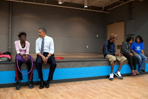 President Barack Obama talks to kids during a stop at the Boys and Girls Clubs of Cleveland on Broadway Avenue in Cleveland, Ohio, June 14, 2012. (Official White House Photo by Pete Souza)