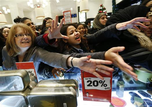 Shoppers beg sales assistants for perfume products in Selfridges on the morning of the Boxing Day sales in London. Retailers in recent years have started sales online on Christmas Day, ahead of the clearances in stores from Boxing Day, but are increasingly launching their online offers before Christmas after delivery deadlines for the day have passed. REUTERS/Olivia Harris (BRITAIN - Tags: BUSINESS