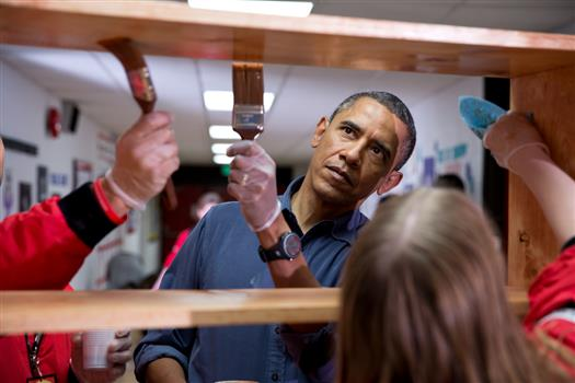 President Barack Obama helps stain shelves during a National Day of Service school improvement project at Burrville Elementary School in Washington, D.C., Saturday, Jan. 19, 2013. (Official White House Photo by Pete Souza)