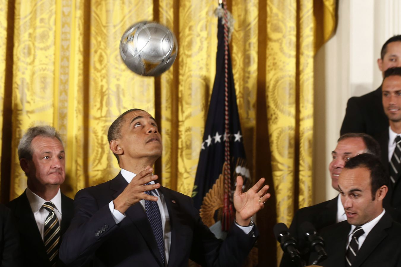 U.S. President Barack Obama bounces a soccer ball off his head after receiving it as a gift while hosting the 2012 Major League Soccer (MLS) Cup winner Los Angeles Galaxy, at a ceremony in the East Room of the White House in Washington, March 26, 2013. REUTERS/Larry Downing