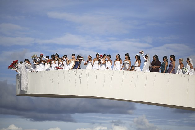 March 26, 2013: Brides pose for photos before a mass wedding ceremony at the Museum of the Republic in Brasilia, Brazil, on March 23. Seventy-eight couples participated.