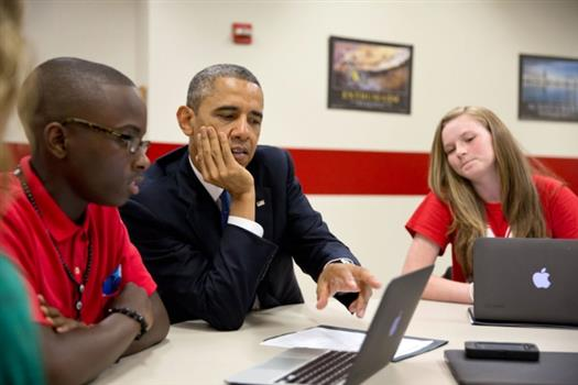 President Barack Obama views student projects created on laptops during a tour at Mooresville Middle School in Mooresville, N.C., June 6, 2013. (Official White House Photo by Pete Souza)
