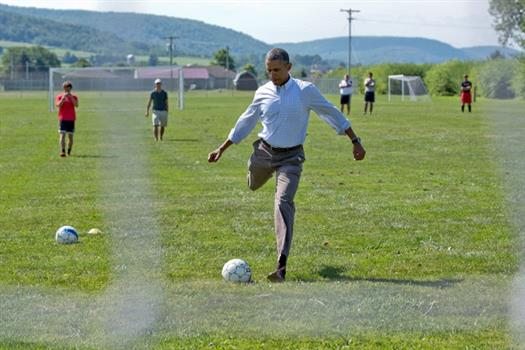 President Barack Obama drops by the Tully Junior-Senior High School soccer practice, during a local stop on the college affordability bus tour in Tully, N.Y., Aug. 23, 2013. (Official White House Photo by Pete Souza)