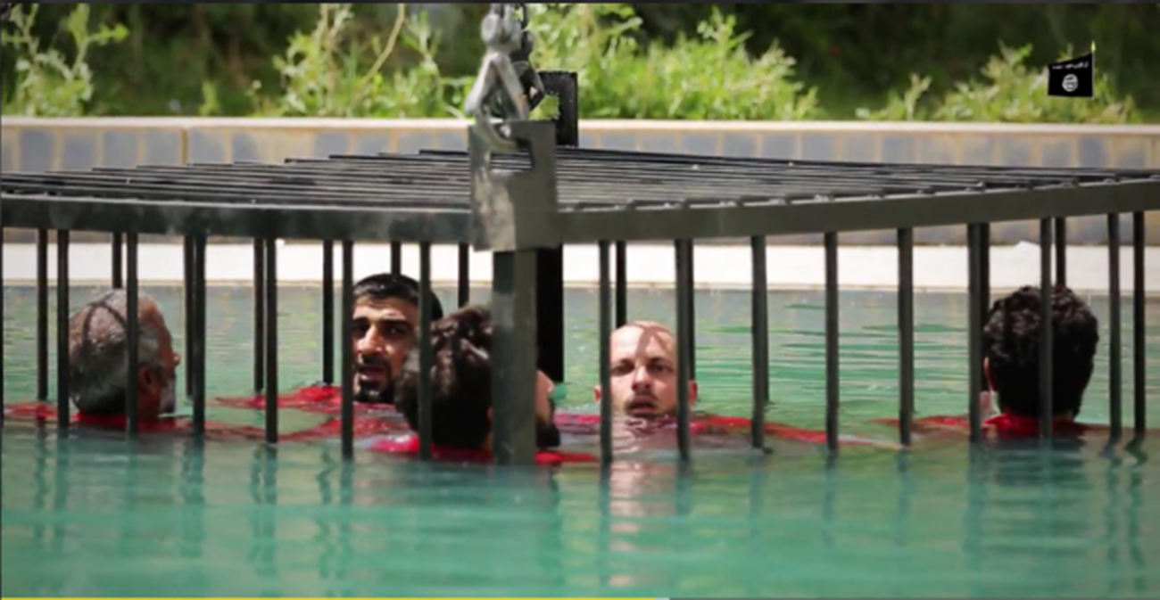 Sickening New ISIS Video Shows Caged Prisoners Drowned in a Swimming Pool, Shot With an RPG and Blown Up With Explosive-Filled Necklaces'